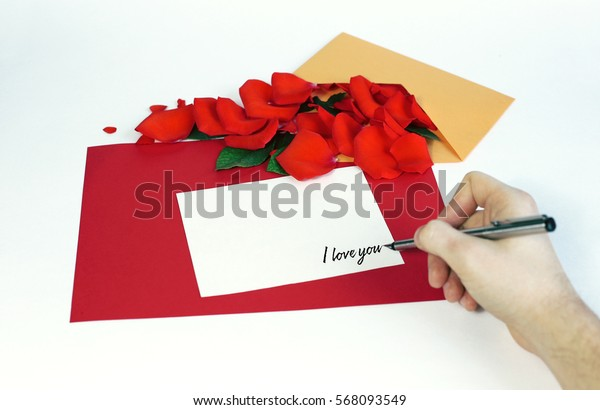Greeting card with rose petals. Yellow, red, white background. hand writing