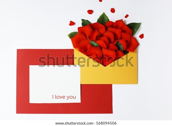 Greeting card with rose petals. Yellow, red, white background. I love you