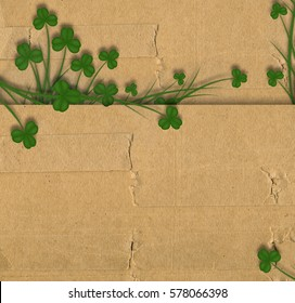 Greeting Card St. Patrick on old paper with green leaves of clover