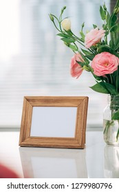 A greeting card template with a place for text, a photo of a blank frame in a bouquet of lisianthus flowers