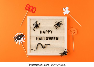 Greeting card with words Happy Halloween and ornate on orange color