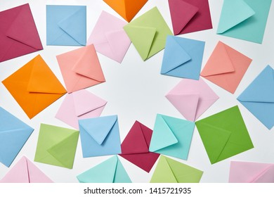Greeting cards of handcraft multicolored envelopes frame on a light background with copy space.