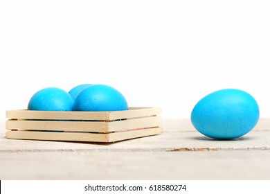 greeting and celebration, robin egg or eggshell blue, traditional easter food painted in bright color in wooden box isolated on white background, future life