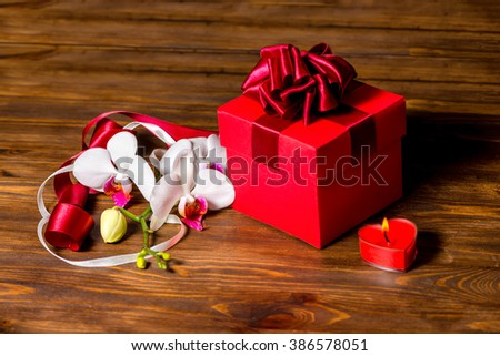 greeting red box with bow candle heart and orchid flower phalaenopsis on wooden background : red box gift - princetonregatta.org
