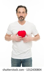 Greeting from sincere heart. Man bearded hipster hold heart. Celebrate valentines day. Love and romantic feelings concept. Fall in love. Me to you. Heart attribute of valentine. Heart gift or present.