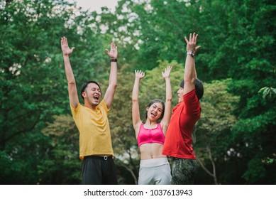 Greeting sport team standing in the garden
