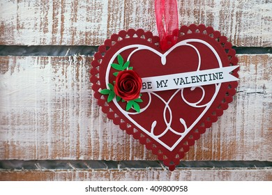 Greeting Valentine's day card on wooden background