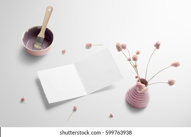 Greetings card scene mockup, perspective view, with decor elements, flowers, paint brush and blank copy, logo space on white background.