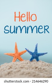 Greetings card with starfishes on sand and text Hello Summer