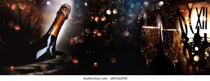 Greetings for a new year 2021. Festive new years eve background with champagne and clock. Concept for celebrations with space for text.