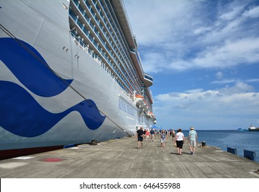 GRENADA, CARIBBEAN - MARCH 25, 2017: Passengers from Royal Princess ship leave the vessel in Saint George port. Royal Princess is operated by Princess Cruises and has a capacity of 3600 passengers