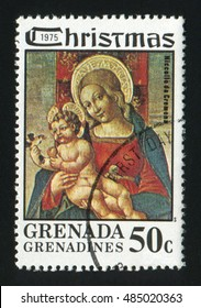 GRENADA - CIRCA 1975: A Christmas post stamp printed in Grenada shows image paint Madonna and Child by Niccola Da Cremona, circa 1975
