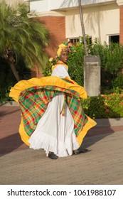 GRENADA ISLAND-Woman dancing at harbor in Grenada Caribbean sea on December 2017