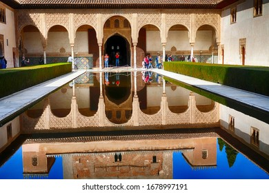 GRENADA, SPAIN - MAR 8, 2020 - Arabic style buildng and interior garden with reflecting pool in the Alhambra Palace, Grenada, Spain