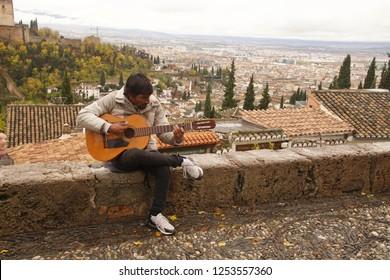GRENADA, SPAIN - NOV 23, 2018 - Flamenco guitar player in the Grenada, Spain
