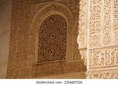 GRENADA, SPAIN - NOV 23, 2018 - Elaborate Islamic designed columns and arabesque window in the Alhambra Palace, Grenada, Spain