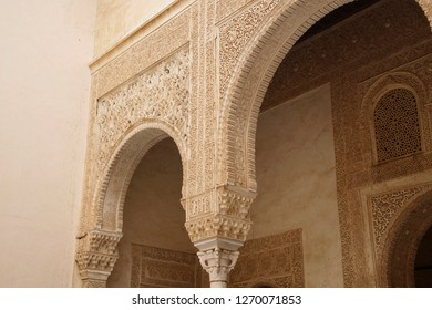 GRENADA, SPAIN - NOV 23, 2018 - Elaborate Islamic designs on interior courtyard of the Alhambra Palace, Grenada, Spain
