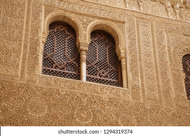 GRENADA, SPAIN - NOV 23, 2018 - Islamic patterns on windows of the Alhambra Palace, Grenada, Spain