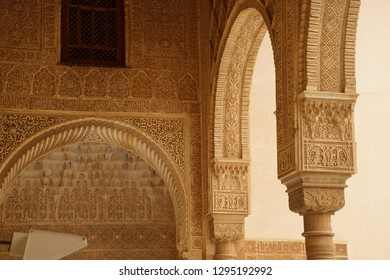 GRENADA, SPAIN - NOV 23, 2018 - Elaborate Islamic designed columns and arabesques   in the Alhambra Palace, Grenada, Spain