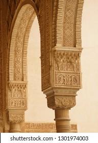 GRENADA, SPAIN - NOV 23, 2018 - Elaborate Islamic designed columns and arabesques   in the Alhambra Palace, Grenada, Spain