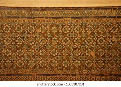 GRENADA, SPAIN - NOV 23, 2018 - Islamic art tiled wall   in the Alhambra Palace, Grenada, Spain