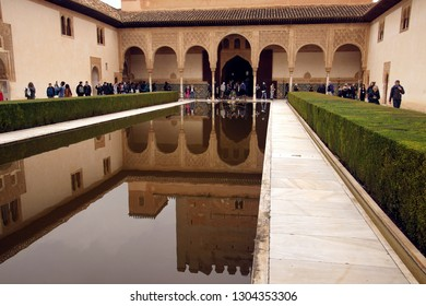 GRENADA, SPAIN - NOV 23, 2018 - Arabic style buidng and interior garden with reflecting pool in the Alhambra Palace, Grenada, Spain