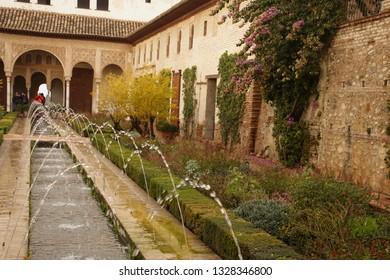 GRENADA, SPAIN - NOV 23, 2018 - Formal garden of Alhambra Palace, Grenada, Spain