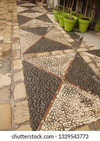 GRENADA, SPAIN - NOV 23, 2018 - Patterned pavement of the mirador in   the Albayzin Arab quarter of Grenada, Spain