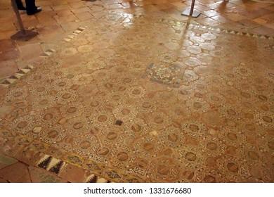 GRENADA, SPAIN - NOV 23, 2018 - Islamic art tiled floor in the Alhambra Palace, Grenada, Spain