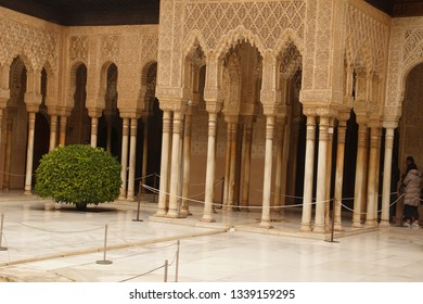 GRENADA, SPAIN - NOV 23, 2018 - Stalactite columns and arches  of the Alhambra Palace, Grenada, Spain