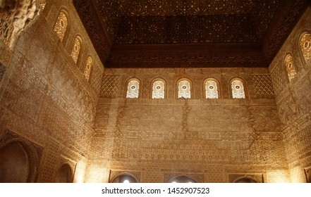 GRENADA, SPAIN - NOV 23, 2018 - Elaborate Islamic designs on interior courtyard of the Alhambra Palace, Grenada, Spain