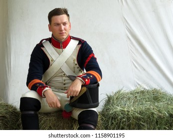 """Grenadier soldier in uniform of the French army of 19th century during the historical festival """"Times and epochs"""" in Moscow, Russia - August 2018. Napoleonic wars reconstruction"""