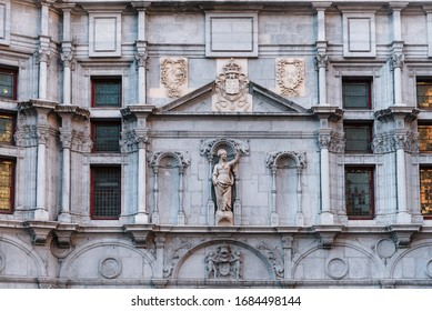Grenoble, France - august 11, 2018. Palace of Parliament of Dauphine with facade in neo gothic and Renaissance styles. Closeup of landmark in Saint Andre Square decorated with sculptures and blazons.