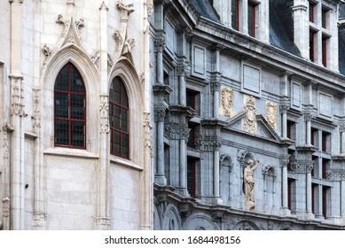 Grenoble, France - august 11, 2018. Palace of Parliament of Dauphine with two-colored facade in neo gothic and Renaissance styles. Landmark in Saint Andre Square decorated with sculptures and blazons.