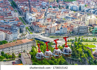 Grenoble, France - June 19, 2016: Picturesque aerial view of Grenoble city, Auvergne-Rhone-Alpes region, France. Grenoble-Bastille cable car on the foreground
