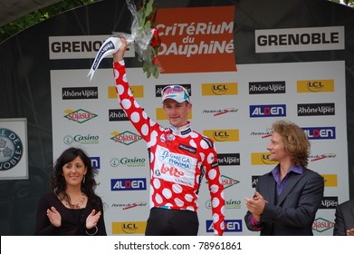 "GRENOBLE, FRANCE - JUNE 8: Professional racing cyclist Jurgen Van Den Broeck wears spotted jersey of UCI WORLD TOUR "" CRITERIUM DU DAUPHINE LIBERE"" time trial on June 8, 2011 in Grenoble, Isere France"