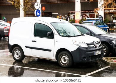 Grenoble, France - March 14, 2019: White compact panel van Renault Kangoo in the city street.