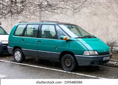 Grenoble, France - March 14, 2019: Green van Renault Espace in the city street.
