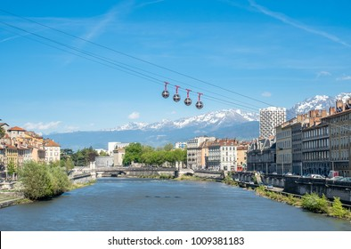 Grenoble-Bastille cable car, four bubbles on sling, transport to hill and fortress of Bastille cross Isere river in Grenoble, France