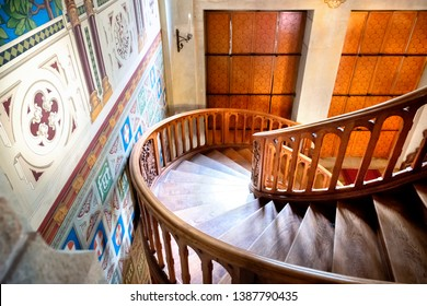 GRESSONEY SAINT JEAN - AOSTA VALLEY - ITALY - APRIL 22, 2019: Savoia Castle inside, the fabulous wooden staircase. Aosta, Italy