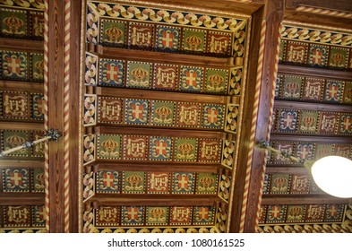 Gressoney-Saint-Jean, Valle d'Aosta region, Italy. 25 April 2018. Castel Savoia, is a villa built in the late 1800s in eclectic style. Wooden coffered ceiling decorated with the Savoyia crests.