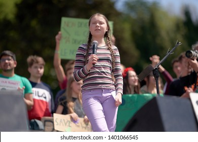 Greta Thunberg, the Famous Swedish Climate Activist in a Flattering Pose During Her Historical Fridays For Future Protest in Rome and the Vatican. Students in Background. ROME, ITALY - April 19, 2019