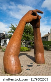 Gretna Green, Scotland - August 24th 2018: A sculpture of clasping hands at the historic Gretna Green in Scotland - the village is famous for runaway weddings and romance.