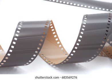Grey 35 mm or photo film strip in spiral over white surface isolated background concept