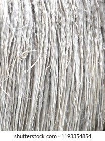 grey alpaca animal fleece un washed and knotty with small pieces of grass, full frame image backgound to ad copy space