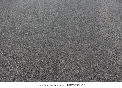 Grey Asphalt Pavement as Material Background