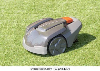 grey autonomous electric lawn mower robotic Lawnmower