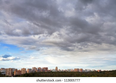 grey autumn clouds under city afternoon
