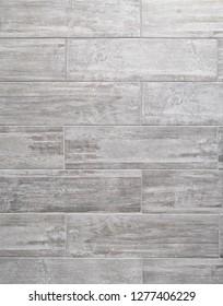 Grey bathroom wall made with rectangular ceramic tiles