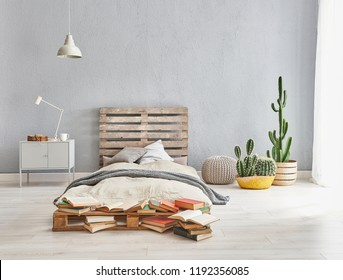 grey bed room style scattered design. grey background stone wall and wooden pallet bedhead.